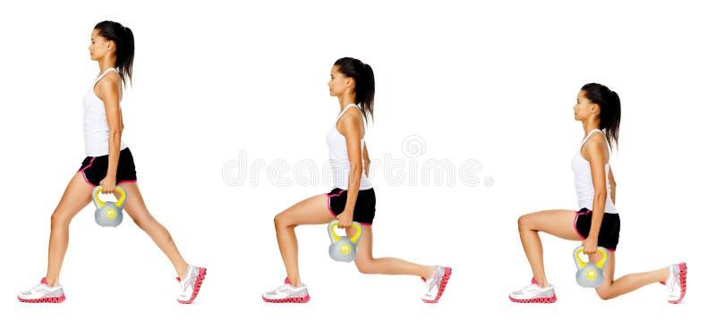 Exercice de dumbell de Kettlebell photographie stock