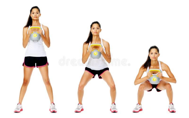 Exercice de dumbell de Kettlebell images stock