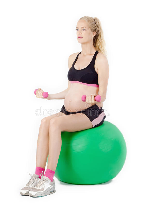 Exercice de forme physique de femme enceinte photographie stock