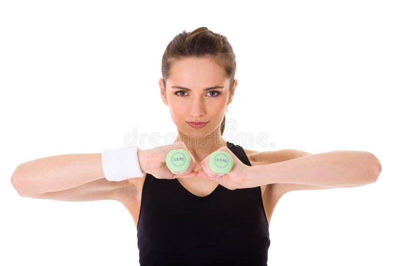 Exercice femelle attrayant utilisant demi de poids de kilo photographie stock libre de droits