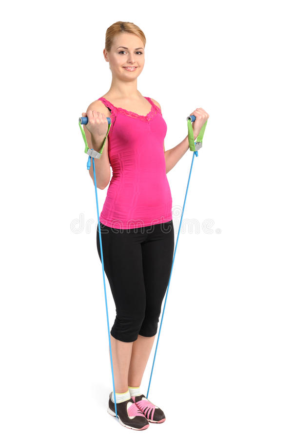 Exercice femelle de biceps utilisant la bande en caoutchouc de résistance photographie stock libre de droits