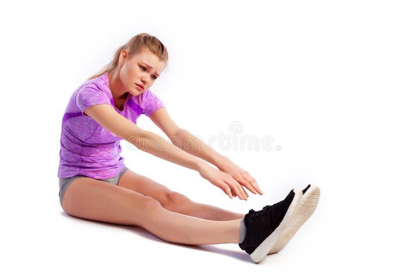 Exercices de sport sur un fond blanc photos libres de droits