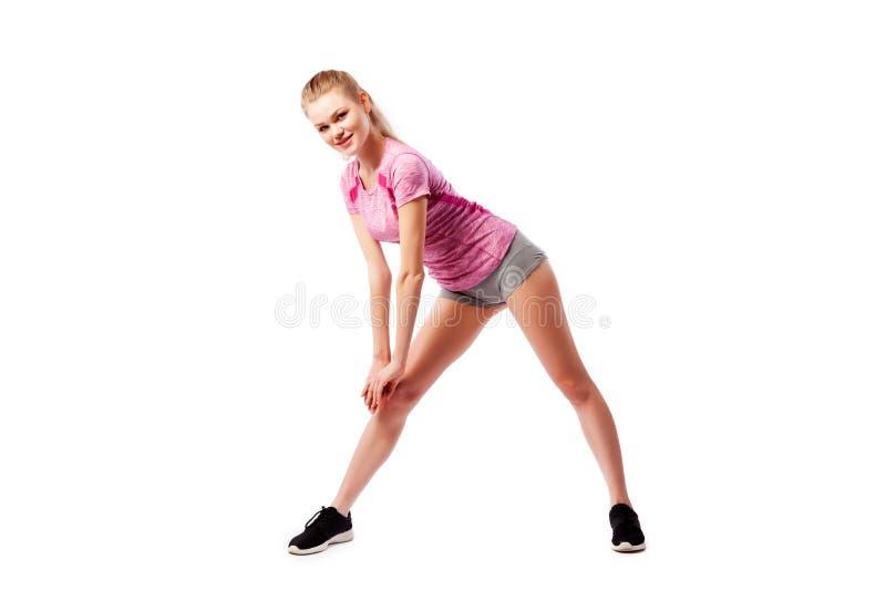Exercices de sport sur un fond blanc photos stock