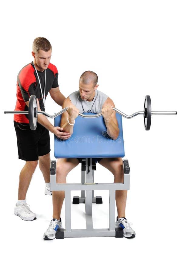 Exercis dos homens do atleta com instrutor pessoal imagem de stock royalty free