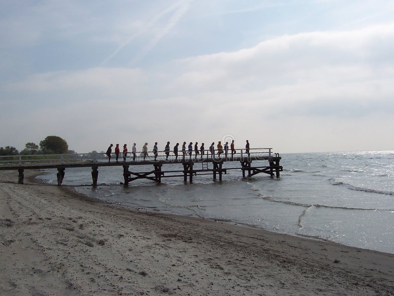 Exercise at the beach. Springtime at the seaside a group of guests keep fit stock photo