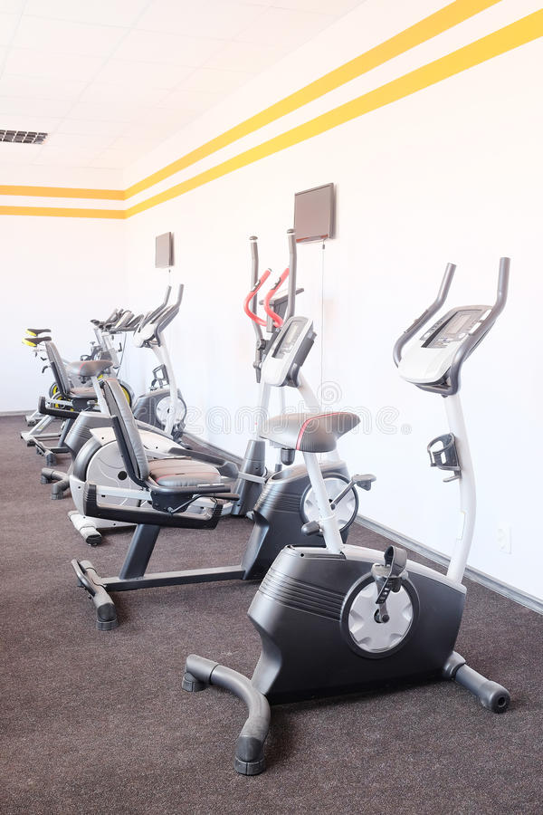 Exercise bicycle. In a fitness hall royalty free stock photography