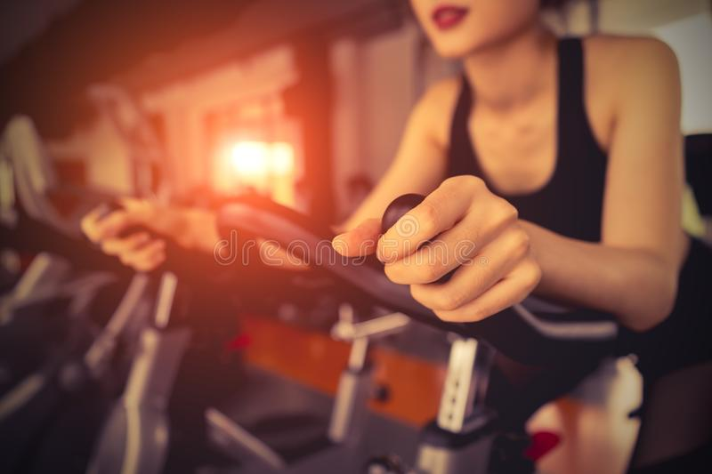 Exercise bike cardio workout at fitness gym stock photos