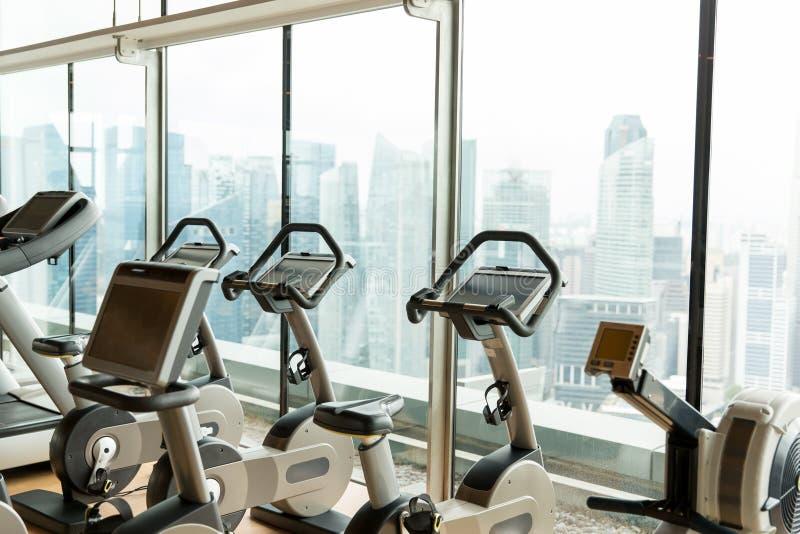 Exercise bikes in city gym royalty free stock photo