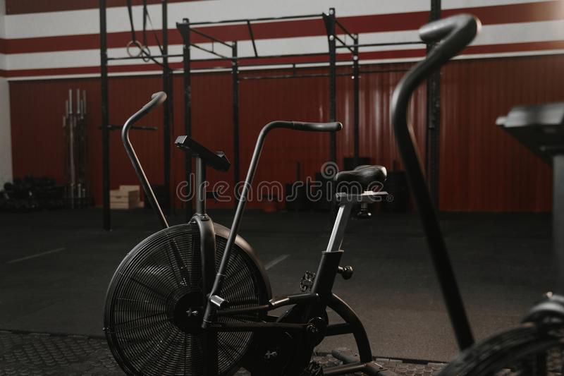Exercise bikes in red color gym. Exercise bikes for cardio in red color crossfit gym royalty free stock photography