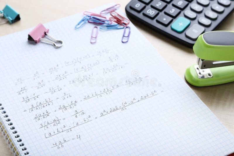 Maths formulas. Exercise book with maths formulas and school supplies stock photos
