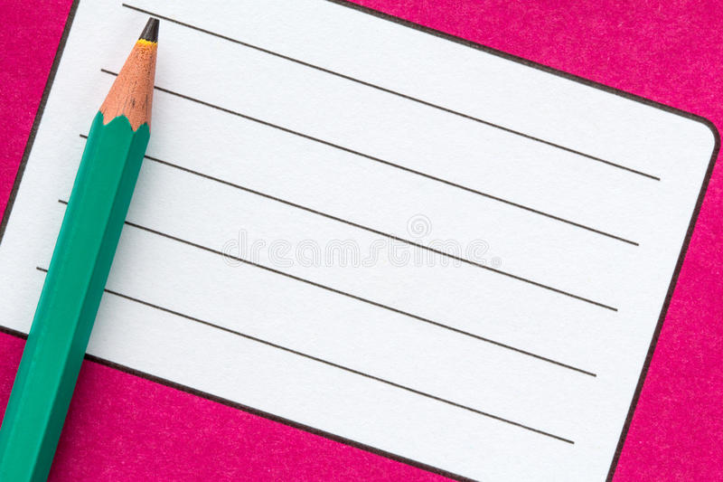 Exercise book name label and pencil. Close up of school exercise book, with name label and pencil royalty free stock images