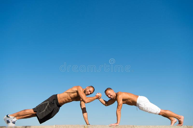 Daily exercise concept. Push ups challenge. Men motivated workout outdoors. Improve endurance by push ups. Men shirtless. Practice push up. Sportsmen improve stock images
