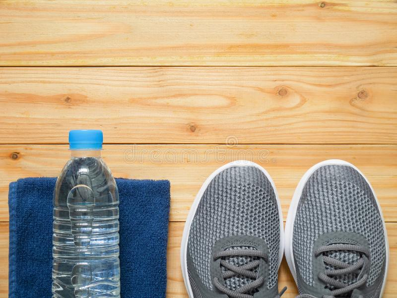 Exercise and fitness equipment on wooden background. In the gym with copy space. Top view stock photography