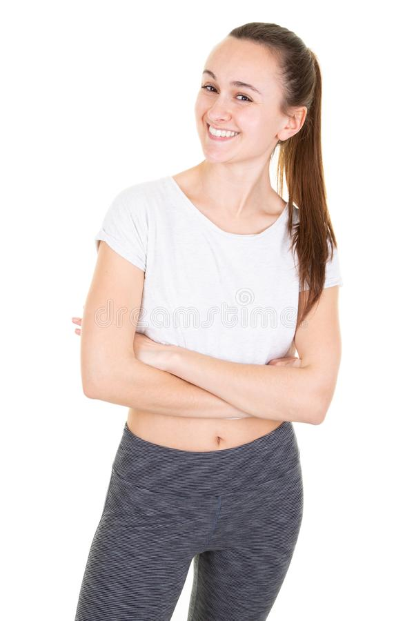 Exercise fitness woman ready for workout standing isolated on white background. Sporty fit beautiful girl Caucasian female fitness. An exercise fitness woman royalty free stock photos