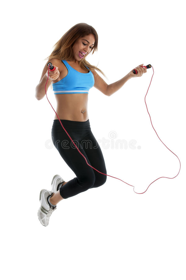 Exercise: Jump Rope. Young adult woman exercising with jump rope. Motion blur Shot on white background stock images