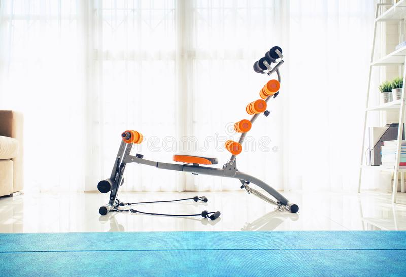 Exercise machines sit-ups at the home.  stock photography