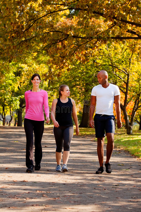 Exercise Park. Three people walking in a park, getting some exercise stock photos