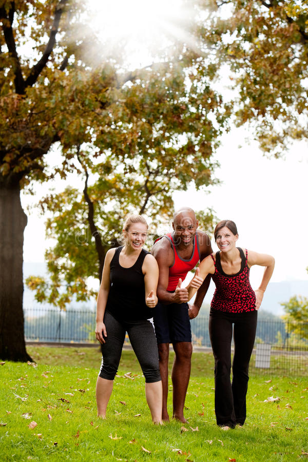 Exercise Park Happy. A group of friends exercising in the park - giving the thumbs up royalty free stock photo