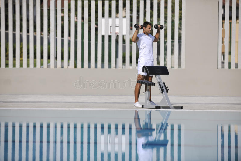 Download Exercise at poolside stock photo. Image of handsome, adult - 15658252