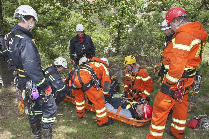 Exercise rescue units. Training rescue people in inaccessible terrain royalty free stock photography
