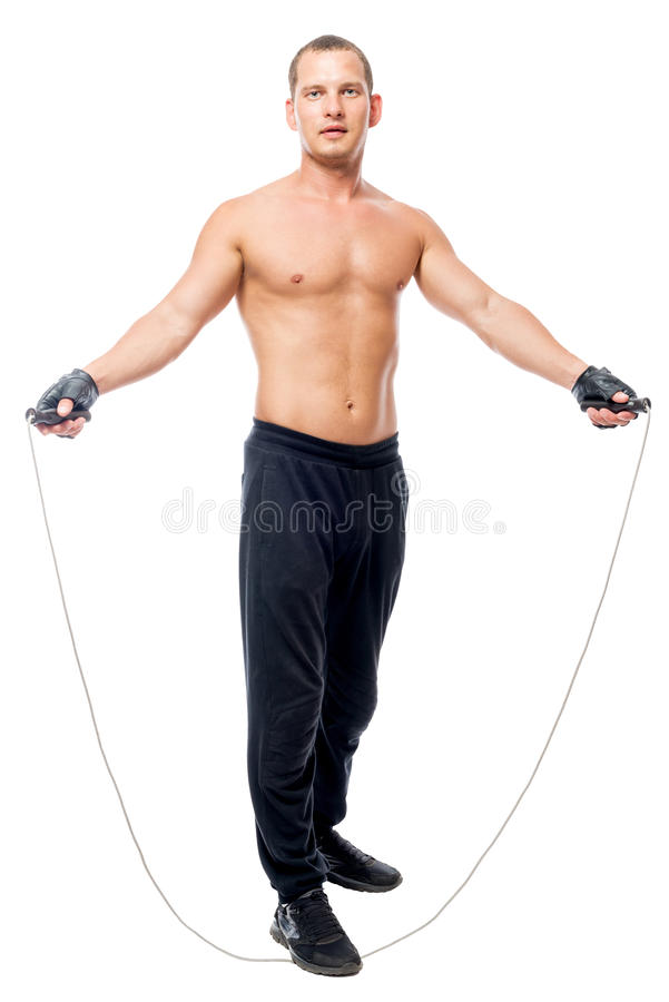 Exercise with a skipping rope, sportsman posing. On a white background royalty free stock photography