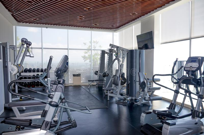Exercise sport machines in the gym. The exercise sport machines in the gym royalty free stock photo