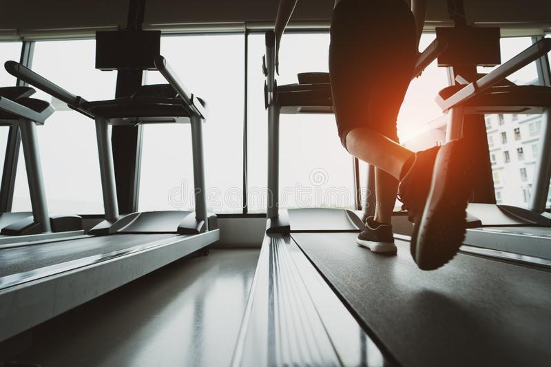 Exercise treadmill cardio running workout at fitness gym of woman taking weight loss royalty free stock photo