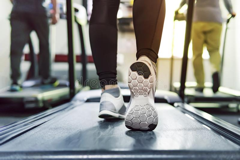 Exercise treadmill cardio running workout at fitness gym of woman taking weight loss with machine aerobic for slim and firm health royalty free stock photos