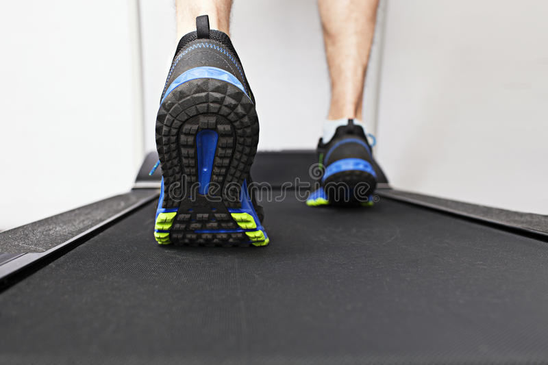 Exercise on a treadmill. Running on a treadmill at the gym royalty free stock photo