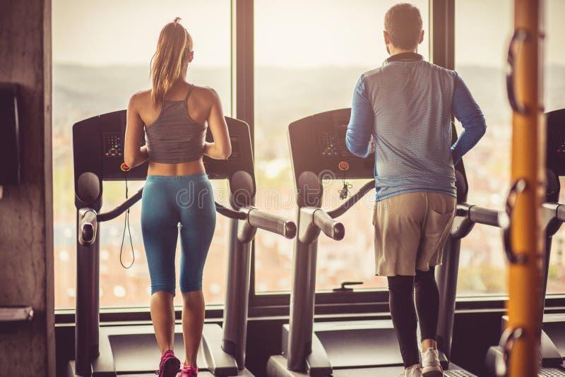 Exercise on treadmill. stock photos