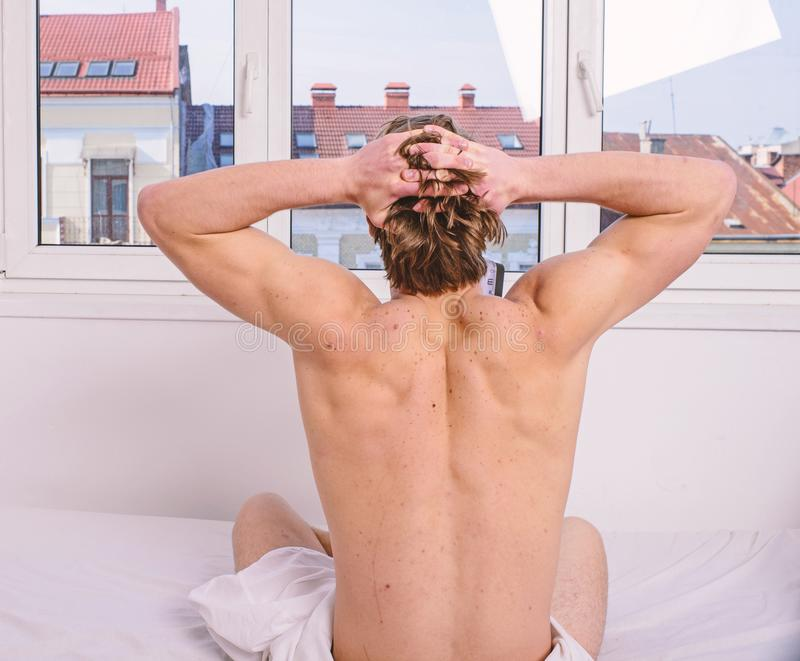 Exercise daily. Vigorous exercise is best but even light exercise better than no activity. Man muscular back stretching stock images