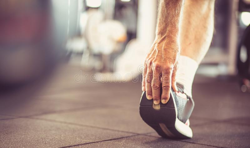 Exercise for the whole body. Senior man stretching and working exercise for leg. Close up stock images