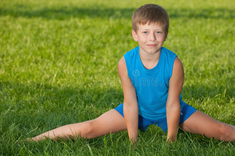 Download Exercises on the grass stock image. Image of sport, lifestyles - 20703229