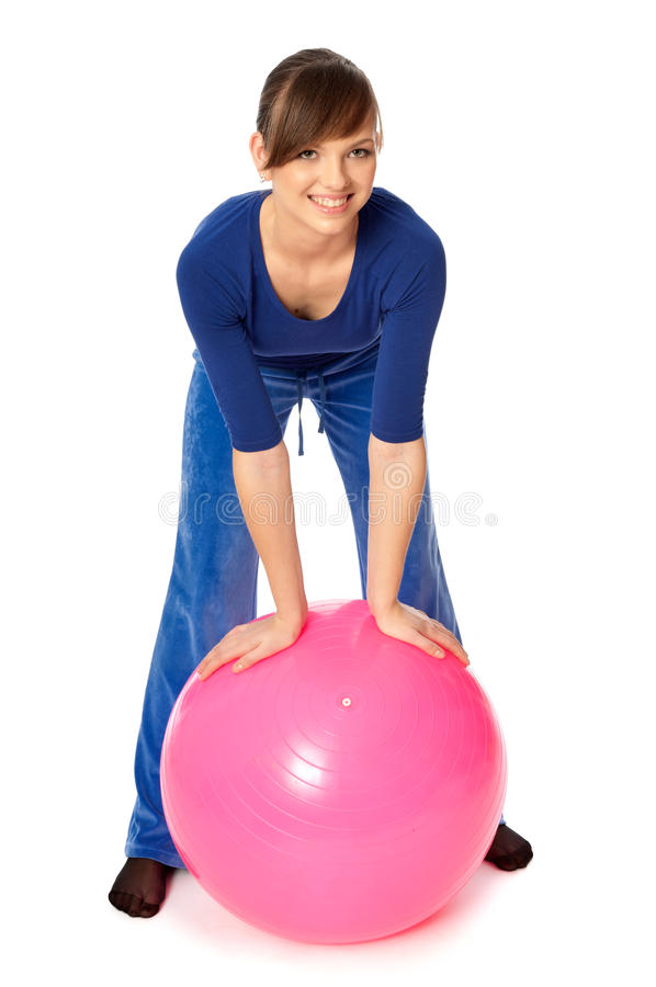 Exercises on a gymnastic ball stock images