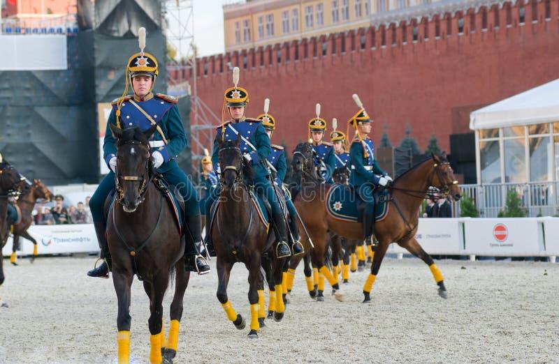 Exercises on horseback. MOSCOW - SEPTEMBER 9: The Honor Cavalry Escort presentation on International Military Music Festival Spasskaya Tower on September 9, 2013 stock images