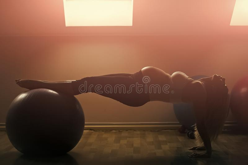 Exercises for pregnant women. Prenatal fitness, yoga and healthy lifestyle. Mother with big belly expecting baby. Pregnant woman exercising with fit ball in stock images