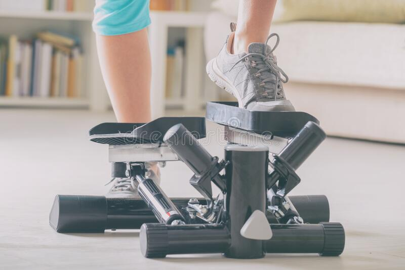 Exercises with stepper at home royalty free stock photo