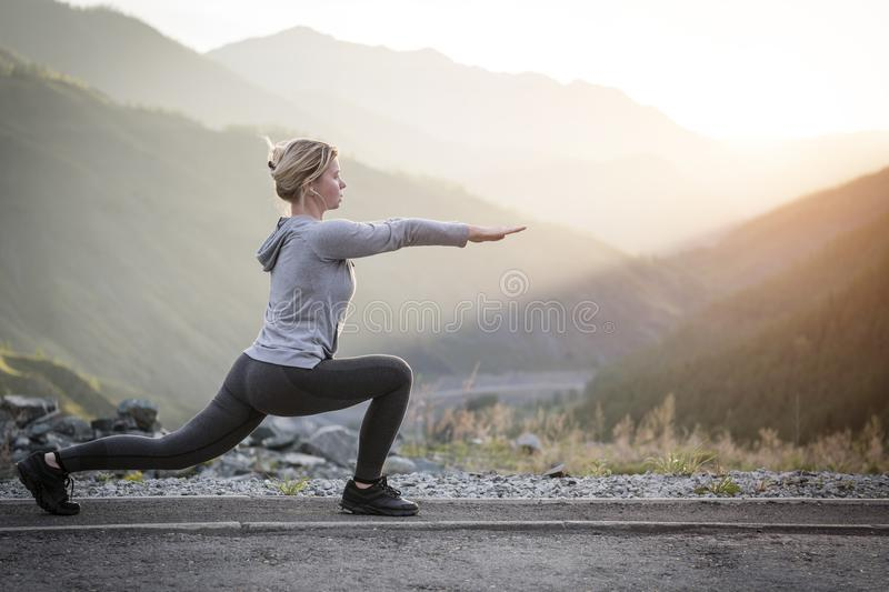 Exercising adult woman outdoors. Sports and recreation. Fitness. stock photo