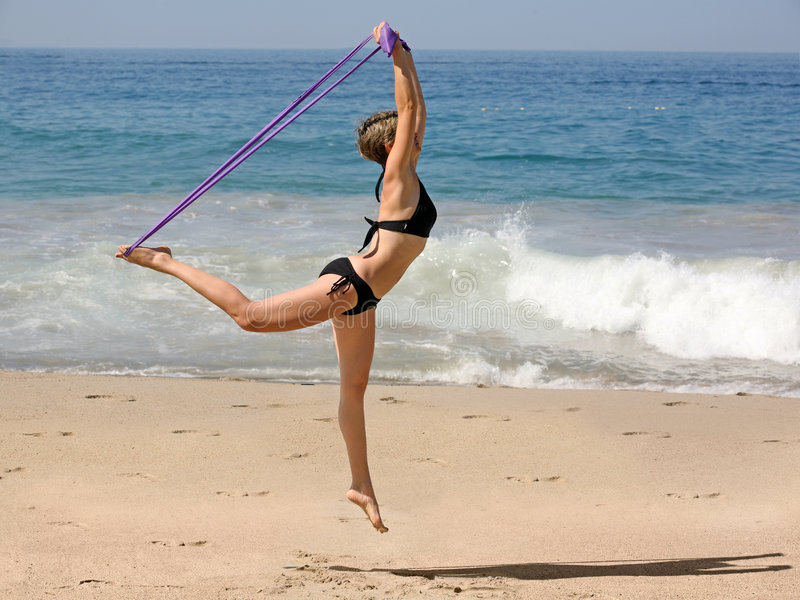 Exercising on the beach royalty free stock photos