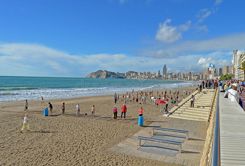 Exercising On The Beach In Benidorm stock images