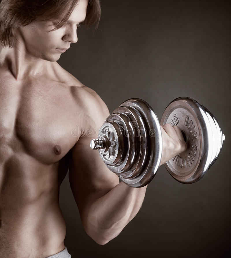 Download Exercising with dumbbell stock image. Image of masculine - 28761995