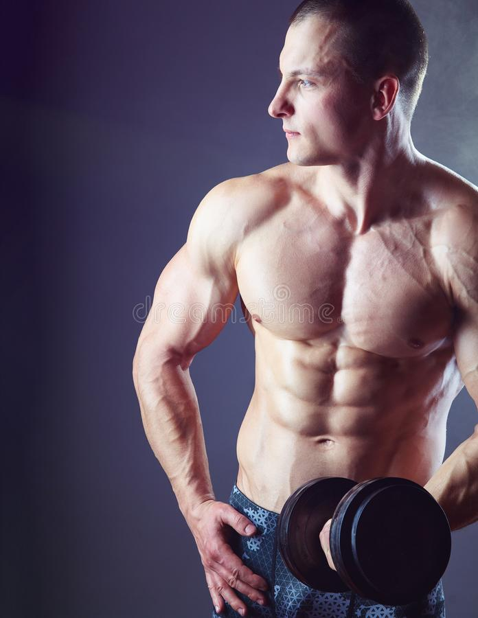 Exercising with dumbbell stock image