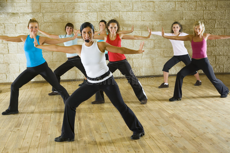 Exercising with fitness instructor stock images