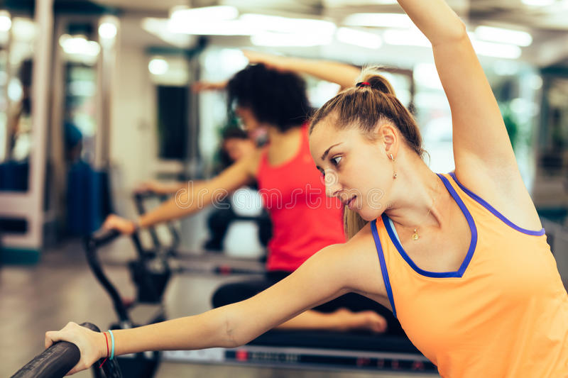 Exercising in a pilates room stock photography