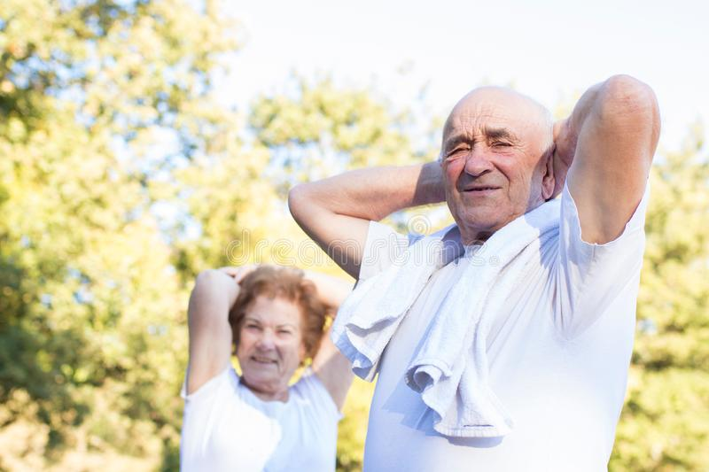 Exercising Seniors. A pair of seniors being active royalty free stock image