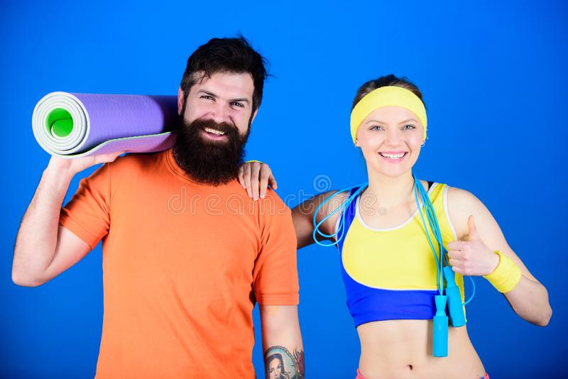 Exercising together is fun. Healthy lifestyle concept. Man and woman exercising with yoga mat and jump rope. Fitness. Exercises. Workout and fitness. Girl and royalty free stock photography