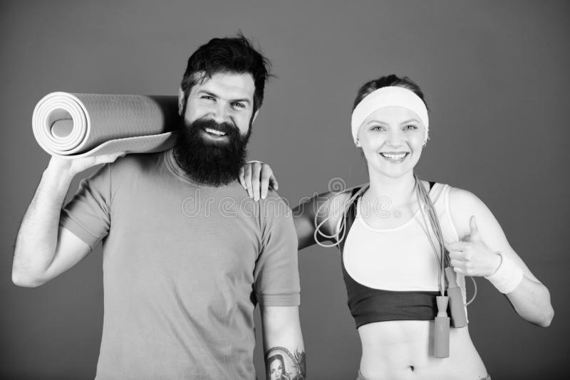 Exercising together is fun. Healthy lifestyle concept. Man and woman exercising with yoga mat and jump rope. Fitness. Exercises. Workout and fitness. Girl and royalty free stock photos