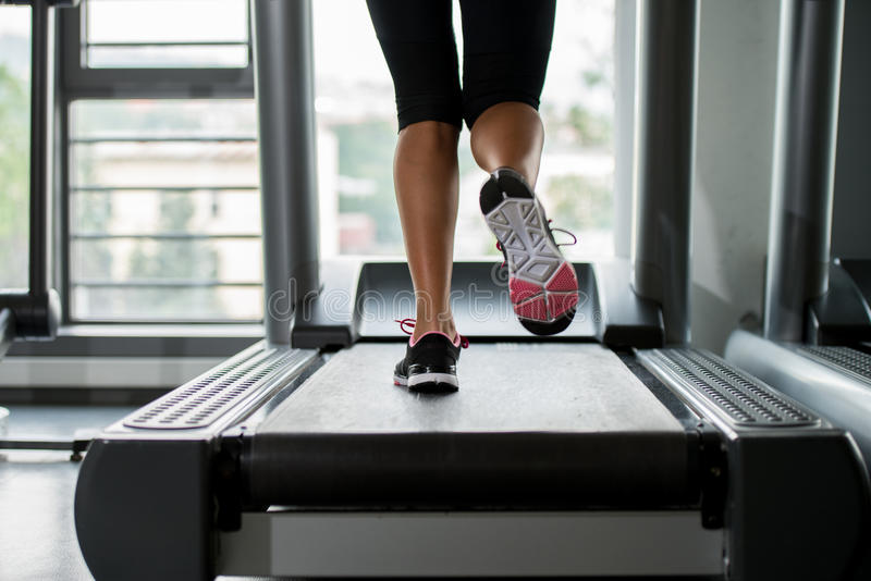 Exercising on a treadmill. In a gym stock photo
