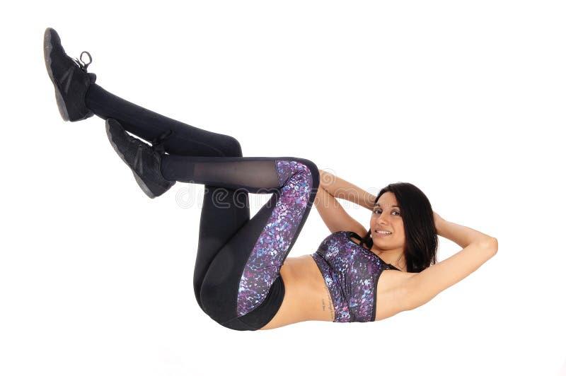 Exercising woman making push ups. stock photo