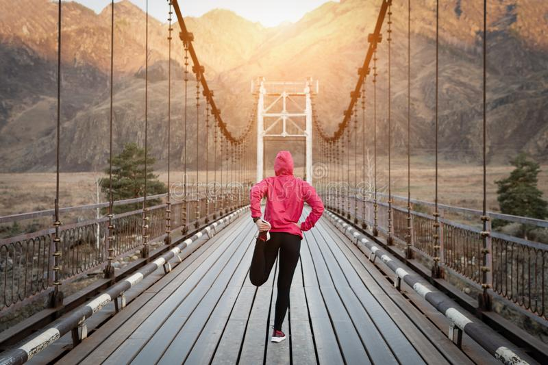 Exercising woman outdoors before the run. Morning training royalty free stock photography